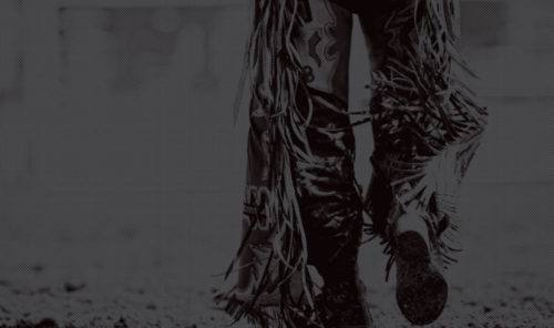 stylized image of man from waist down wearing fringed rawhide pants