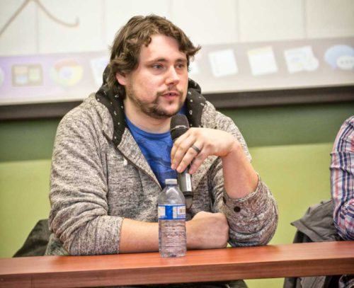 James Black holding microphone at a panel